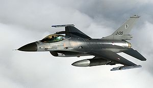 """Leeuwarden Air Base - A Royal Netherlands Air Force F-16 Fighting Falcon """"J-135"""". Note the depiction of the Frisian flag and the mascot Polley Grey on the tail."""
