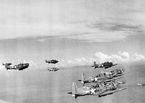 "Santa Isabel Island - U.S. Navy Douglas SBD-3 Dauntless dive bombers of scouting squadron VS-6 en route to attack the Japanese seaplane base at Rekata Bay, Santa Isabel Island, August–September 1942. VS-6 operated from the aircraft carrier USS Enterprise (CV-6) in the Solomons until she had to return to Pearl Harbor, Hawaii (USA), after the Battle of the Eastern Solomons on 24–25 August 1942. VS-6 (and VB-6 crews) under CO Turner Cladwell then operated for another month from Henderson Field, Guadalcanal, known as ""Flight 300"" (from the Enterprise flight schedule on 24 August)."