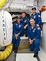 STS-135 crew in the White Room.jpg