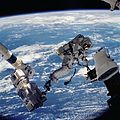 STS112 EVA 1 David Wolf anchored to SSRMS.jpg