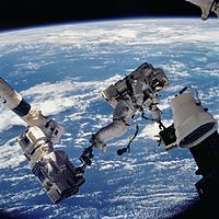 STS112 EVA 1 David Wolf anchored to SSRMS