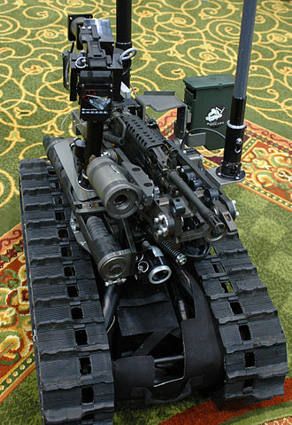Foster-Miller TALON - The SWORDS system allows soldiers to fire small arms weapons by remote control from as far as 1,000 meters away. This example is fitted with an M249 SAW.