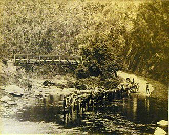 Saasveld Forestry College - Ox-wagon crossing the Kaaimans River in late 19th century