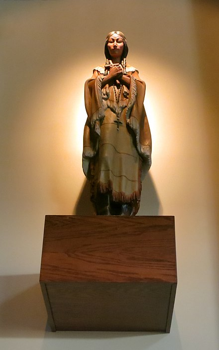 Saint Kateri Tekakwitha, the patron of ecologists, exiles, and orphans, was canonized by the Catholic Church. Saint John Neumann Catholic Church (Sunbury, Ohio) - interior, statue of Saint Kateri Tekakwitha.jpg
