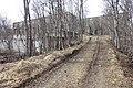 Salangsverket Reinforced concrete ruins of iron ore mining industrial plant (jernbrikettstøperi havn etc) 1907–1912 Langneset Salangen Troms Northern Norway Spring naked trees etc 2019-05-07 09111.jpg