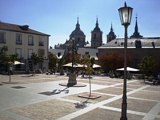 San Lorenzo de El Escorial - Plaza de la Constitución. In the background, the Monastery.