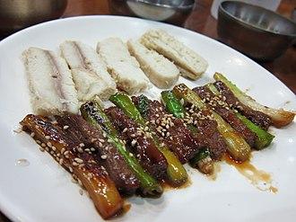Shark meat - Sanjeok (skewered beef and scallions) and dombaegi (salted shark meat)