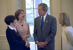 Figure skating at the 2002 Winter Olympics - Ladies' Singles Gold medalist Sarah Hughes meets with President George W. Bush in Washington D.C. on April 12, 2002.
