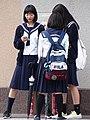 Schoolgirls in Street - Asahikawa - Hokkaido - Japan (48018181627).jpg