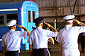 Senior leaders from the different military service branches salute a bus leaving the repatriation ceremony area September 15, 2000 000829-F-QT350-005.jpg