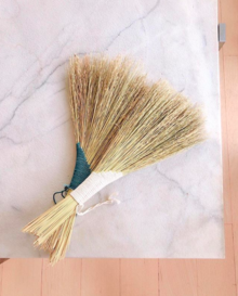two turkey tail brooms made from broom corn