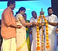 Smriti Irani lighting the traditional lamp at the inaugural function of the permanent campus of Indian Institute of Science Education and Research (IISER), in Thiruvananthapuram. The Chief Minister of Kerala.jpg