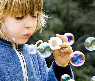 Child development - Child playing with bubbles