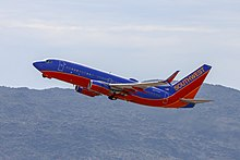 3d99e9afe7e7 A Southwest 737-700 departing Phoenix Sky Harbor International Airport.