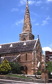 The east end of St Mark's showing simple untraceried lancet windows, and the spire rising from a square-topped tower without pinnacles or broaches.