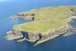 Aerial view of Staffa, with The Colonnade in the foreground and Am Buchaille to the right