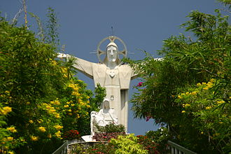 Vũng Tàu - A 32m-high statue of Jesus extending his 18.3m-long arms on the top of 170m-high Nho Mount