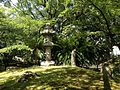 Stone lantern and Cycas revoluta in Suiten Shrine.jpg