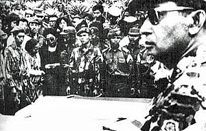 Transition to the New Order - As Major General, Suharto (at right, foreground) attends the funeral of assassinated generals 5 October 1965. (Photo by the Department of Information, Indonesia)