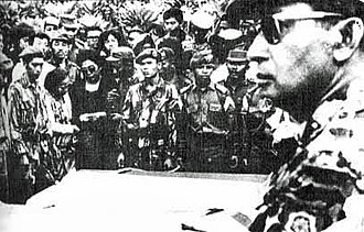 Suharto - As Major General, Suharto (at right, foreground) attends funeral for assassinated generals, 5 October 1965.