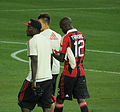 Sulley Muntari and Bakaye Traore walk.jpg