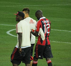 Sulley Muntari - Muntari (left) with Milan teammates El Shaarawy (center) and Traoré (far right)