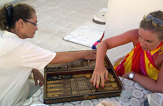 Tables (board game) - Women playing tavla in Turkey.