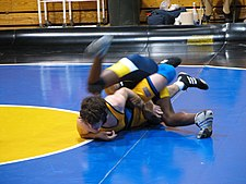 One of the scholastic wrestlers pictured here is escaping from his opponent's control for one point.