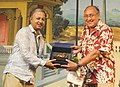 The International Jury Member Victor Banerjee felicitating the Assamese Film Maker Utpal Borpujari, at the Closing Ceremony of the North East Films, during the 44th International Film Festival of India (IFFI-2013), in Panaji.jpg