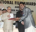The President, Shri Pranab Mukherjee presenting the Rajat Kamal Award for Best Actor (Shared) Perariyathavar (Malayalam) to Shri Suraj Venjaramoodu, at the 61st National Film Awards function, in New Delhi on May 03, 2014.jpg