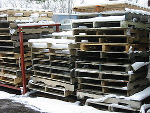 Recycling by material - A tidy stack of pallets awaits reuse or recycling.