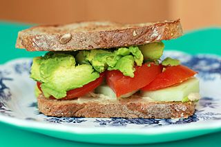 Sandwich Food made of two pieces of sliced bread with fillings such as meat or vegetables in between.