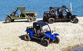 Tomcar - Tomcar TM2 (blue), TM4 (black), and a TM5 (green).