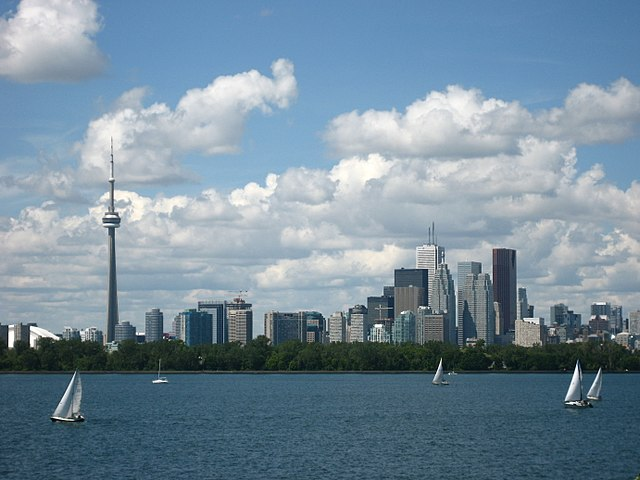 """""""Toronto skyline and waterfront"""" by Derek Tsang from Kingston, Canada - Toronto 18/18 - Welcome HomeUploaded by Skeezix1000. Licensed under Creative Commons Attribution 2.0 via Wikimedia Commons - http://commons.wikimedia.org/wiki/File:Toronto_skyline_and_waterfront.jpg#mediaviewer/File:Toronto_skyline_and_waterfront.jpg"""