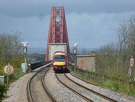 Train approaching Dalmeny Station from the Forth Bridge.JPG