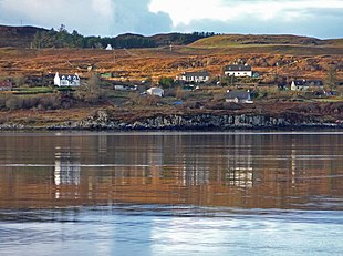The township of Treaslane seen across the water of Loch Snizort Beag.
