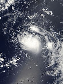 A satellite imagery of a swirling mass of clouds over the open Atlantic.