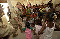 U.S. Air Force Chief Master Sgt. Marcie Hureau leads the Air Force Academy Band in song while dancing with children at the Aicha Bogoreh Center for the Protection of Mothers and Children in Djibouti City 060616-N-CI793-013.jpg