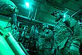 U.S. Air Force Senior Airman Larry Webster, left, and Tech. Sgt. Richard Mulhollen, both C-130H Hercules aircraft loadmasters with the 774th Expeditionary Airlift Squadron, prepare to release cargo over a remote 131007-F-YL744-073.jpg