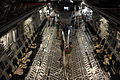 U.S. Air Force loadmasters assigned to the 14th Airlift Squadron and Marines assigned to Marine Medium Tiltrotor Squadron 266 unload a Marine Corps MH-53E Sea Dragon helicopter from the cargo area of a C-17A 100823-F-RR679-214.jpg