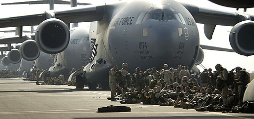 U.S. Army paratroopers prepare to board a C-17 Globemaster III to jump into Northern Iraq, March 26, 2003