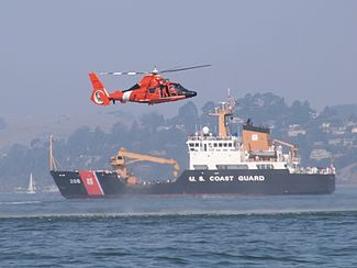 U.S. Coast Guard helicopter and Buoy Tender