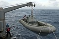 U.S. Navy Boatswain's Mate 3rd Class Joshua Cobbett, background, and Seaman Joel Haworth lower a rigid hull inflatable boat over the port side of the guided missile frigate USS Underwood (FFG 36) during 120827-N-NL541-025.jpg