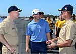 U.S. Navy Vice Adm. David H. Buss, right, the commander of Naval Air Forces, and Capt. Christopher Bolt, left, the commanding officer of the aircraft carrier USS Ronald Reagan (CVN 76), talk with Alex Spanos 130828-N-SS432-001.jpg