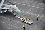 U.S. Sailors tow an EA-6B Prowler aircraft assigned to Electronic Attack Squadron (VAQ) 142 on the flight deck of the aircraft carrier USS Nimitz (CVN 68) July 30, 2013, in the Gulf of Oman 130730-N-KE148-210.jpg