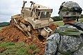 U.S. Soldiers with the 500th Engineer Company, 15th Engineer Battalion use a bulldozer to excavate a hasty position Sept 140903-A-WG858-001.jpg