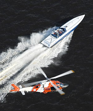 Missions of the United States Coast Guard - A helicopter from HITRON pursues a go-fast boat during drug interdiction training.