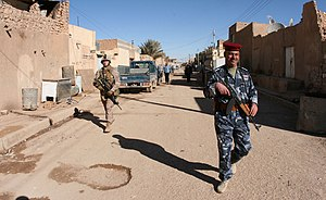 Ar-Rutbah - An Iraqi soldier from the Provisional Security Forces participate in a joint security patrol in Rutbah