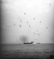 USS Enterprise (CV-6) hit by kamikaze on 21 May 1945 (80-G-323565)