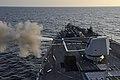USS Jason Dunham fires its MK 45 5-inch gun. (8282018284).jpg
